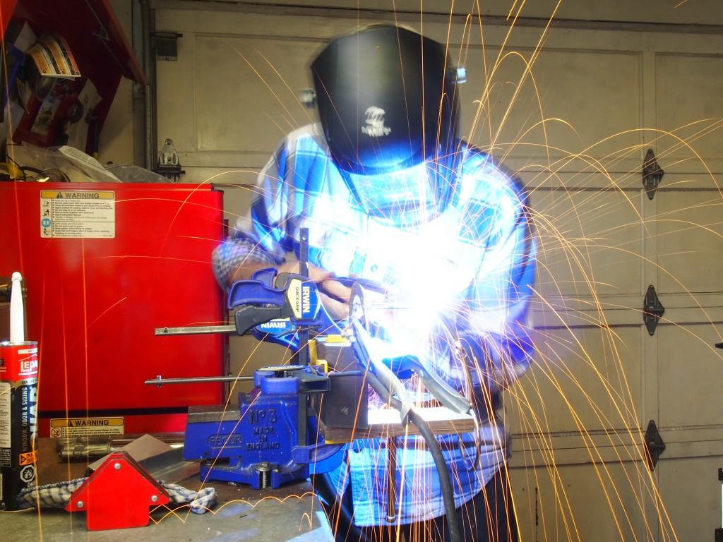 Long exposure welding shot on the horse shoe wine bottle holder