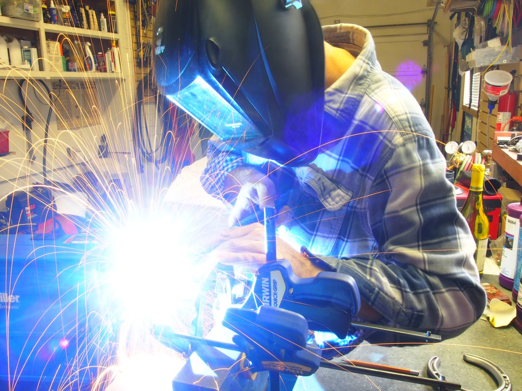 Long exposure welding shot of the horse shoe wine bottle holder