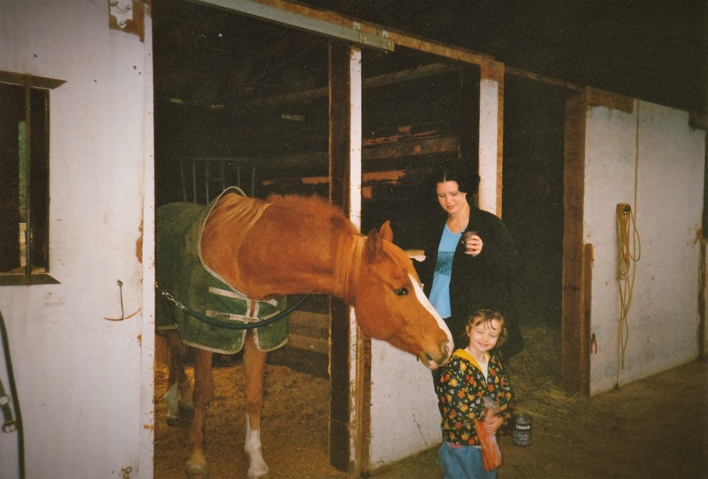 Kid sister with the horse