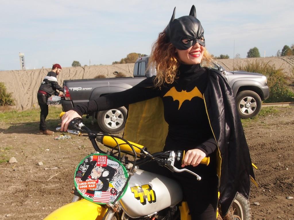 Batgirl posing on a dirtbike at the High Noon Scramble 2015
