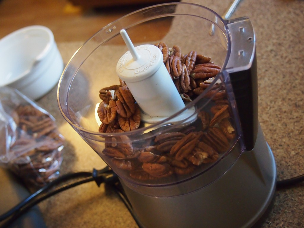Pecans for rolling the thumbprint cookies in