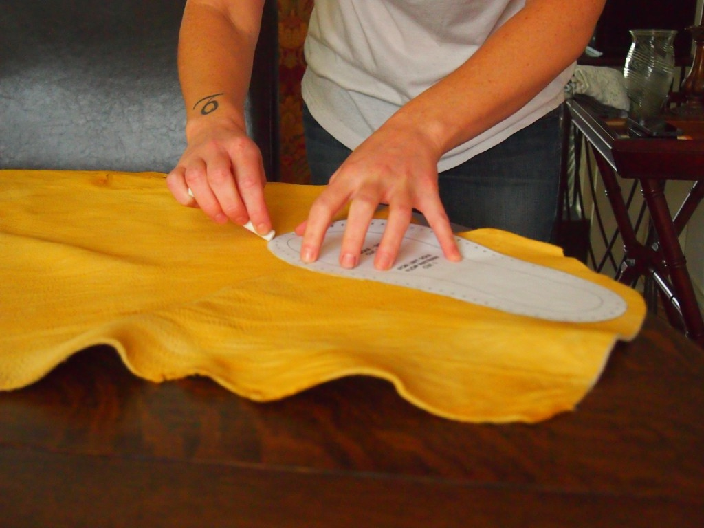 Tracing the moccasin pattern onto the moose hide