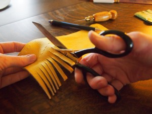 Cutting up the fringe for the moose hide moccasins