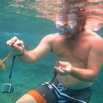 Playing with sea life while snorkeling in Guadeloupe