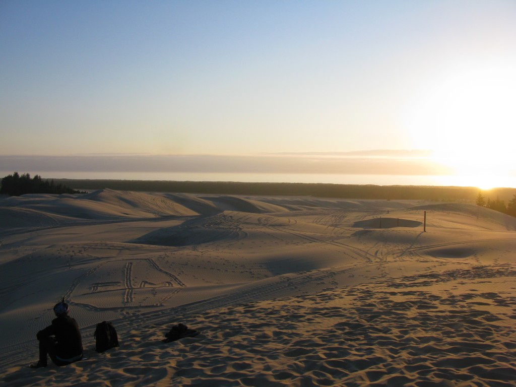 Watching the sunset from the sand dunes on the Oregon Coast