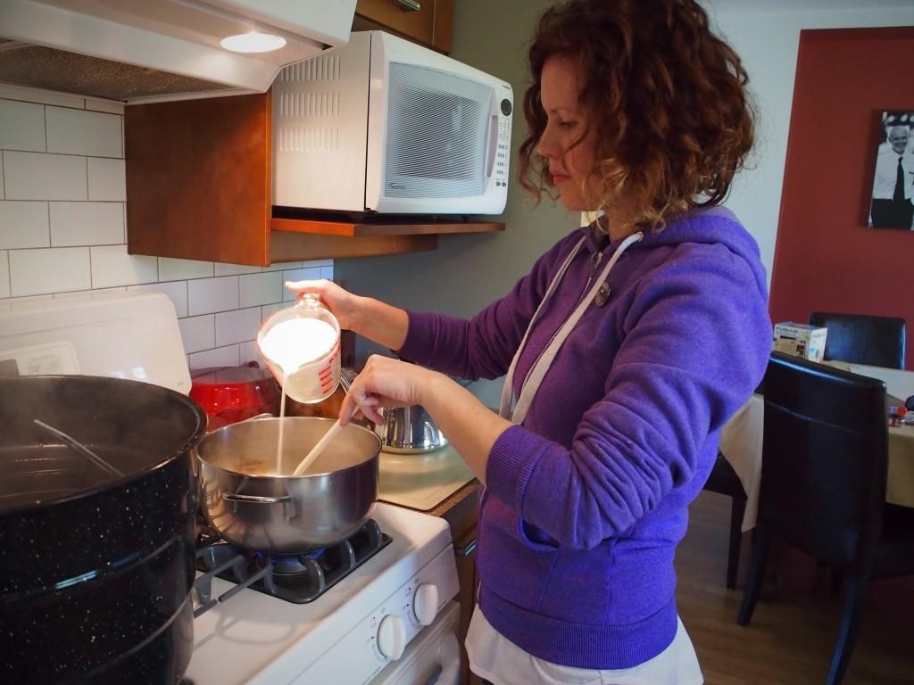 Adding sugar to make dandelion jelly