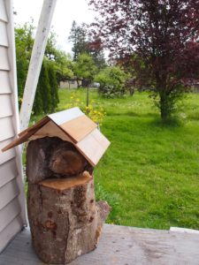 The mason bee log house in it's home