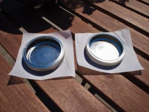 Parchment paper to separate the metal mason jar lids and vinegar