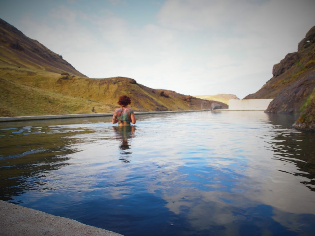 Swimming in seljavallalaug pool in south Iceland on my road trip