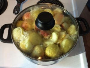 Cooking down the apples for sugar free applesauce