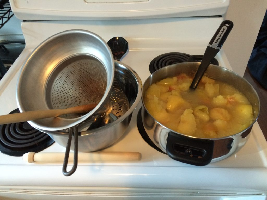 Preparing to mash the apples into sugar free applesauce