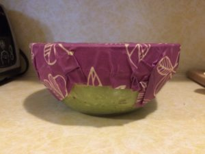 Using bee's wrap to cover a bowl of guacamole