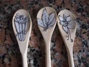 Preparing the art to wood burn on wooden spoons for mothers day